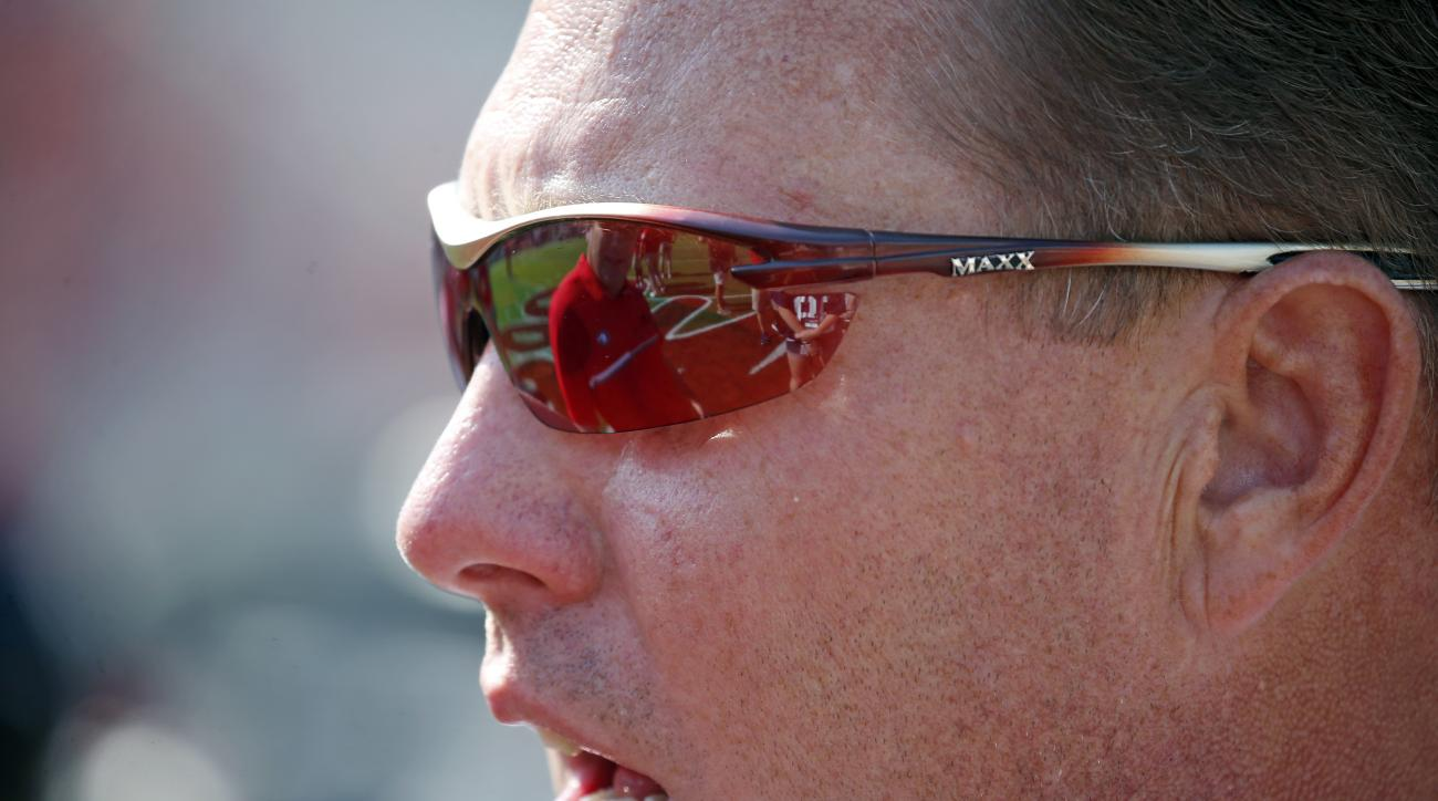 Mississippi head coach Hugh Freeze's sun visors reflect his conversation with Georgia head coach Kirby Smart prior to their NCAA college football game, Saturday, Sept. 24, 2016, in Oxford, Miss. (AP Photo/Rogelio V. Solis)