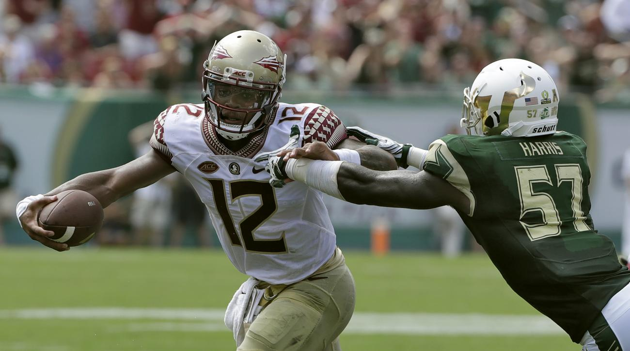 Florida State quarterback Deondre Francois (12) eludes South Florida linebacker Nigel Harris (57) on a run during the first quarter of an NCAA college football game Saturday, Sept. 24, 2016, in Tampa, Fla. (AP Photo/Chris O'Meara)