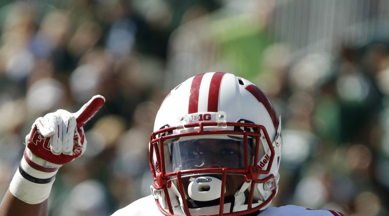 Wisconsin's Corey Clement celebrates his rushing touchdown against Michigan State during the second quarter of an NCAA college football game, Saturday, Sept. 24, 2016, in East Lansing, Mich. (AP Photo/Al Goldis)