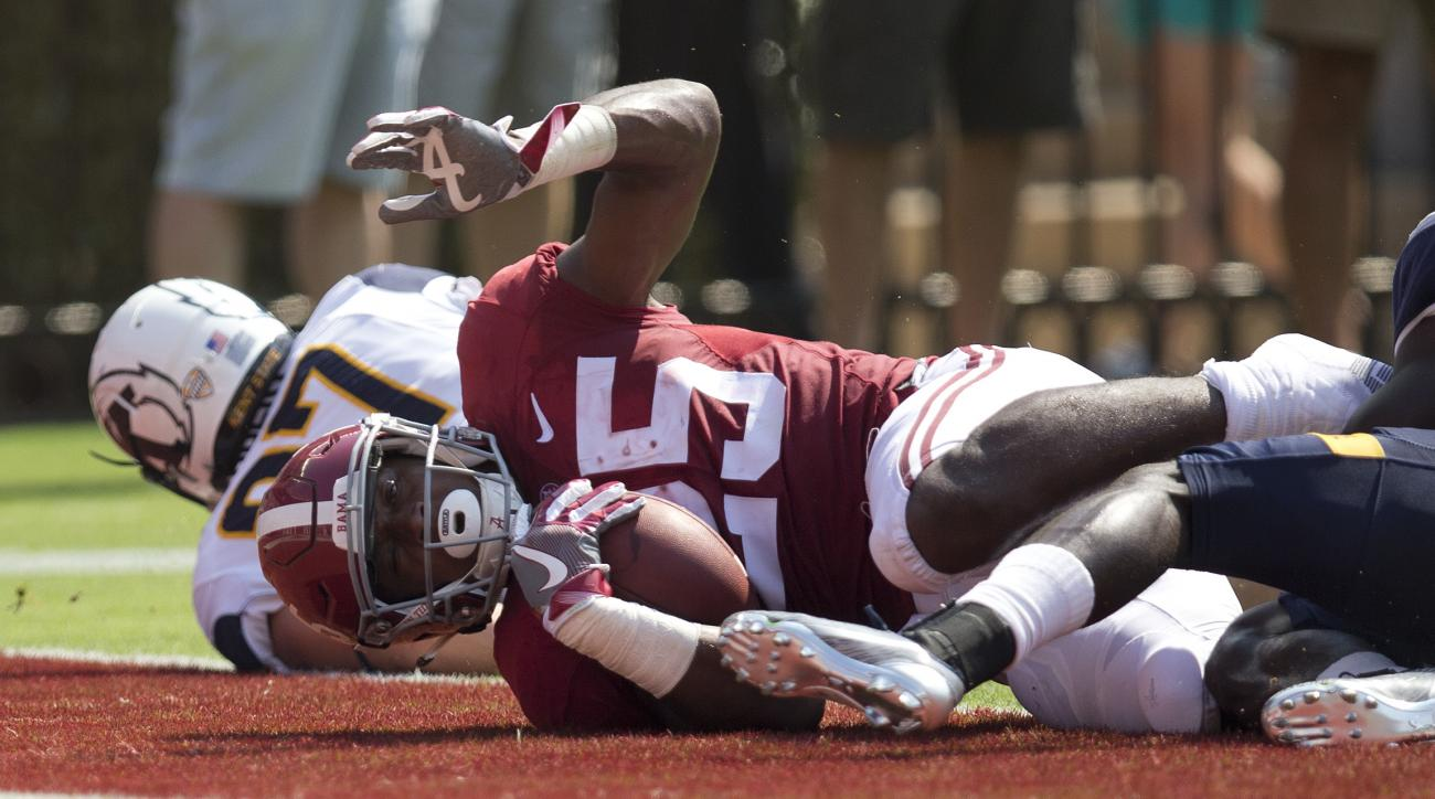 Alabama running back Joshua Jacobs scores a touchdown in the first half during an NCAA college football game against Kent State, Saturday, Sept. 24, 2016, in Tuscaloosa, Ala. (AP Photo/Brynn Anderson)