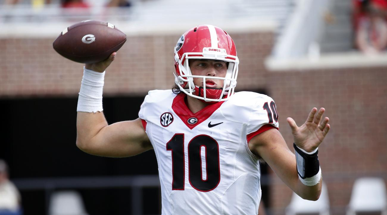Georgia quarterback Jacob Eason (10) sets up to pass against Mississippi during the second half of an NCAA college football game, Saturday, Sept. 24, 2016, in Oxford, Miss. (AP Photo/Rogelio V. Solis)