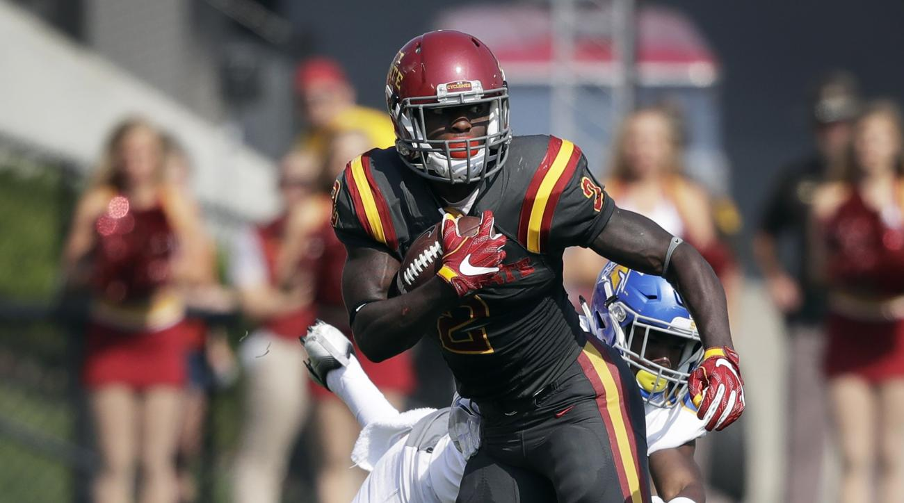 Iowa State running back Mike Warren runs from San Jose State safety Trevon Bierria, rear, after making a reception during the first half of an NCAA college football game, Saturday, Sept. 24, 2016, in Ames, Iowa. (AP Photo/Charlie Neibergall)