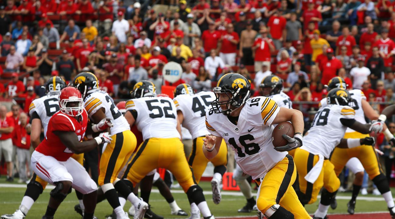 Iowa quarterback C.J. Beathard (16) carries the ball against Rutgers during the first half of an NCAA college football game, Saturday, Sept. 24, 2016, in  Piscataway, N.J. (AP Photo/Noah K. Murray)
