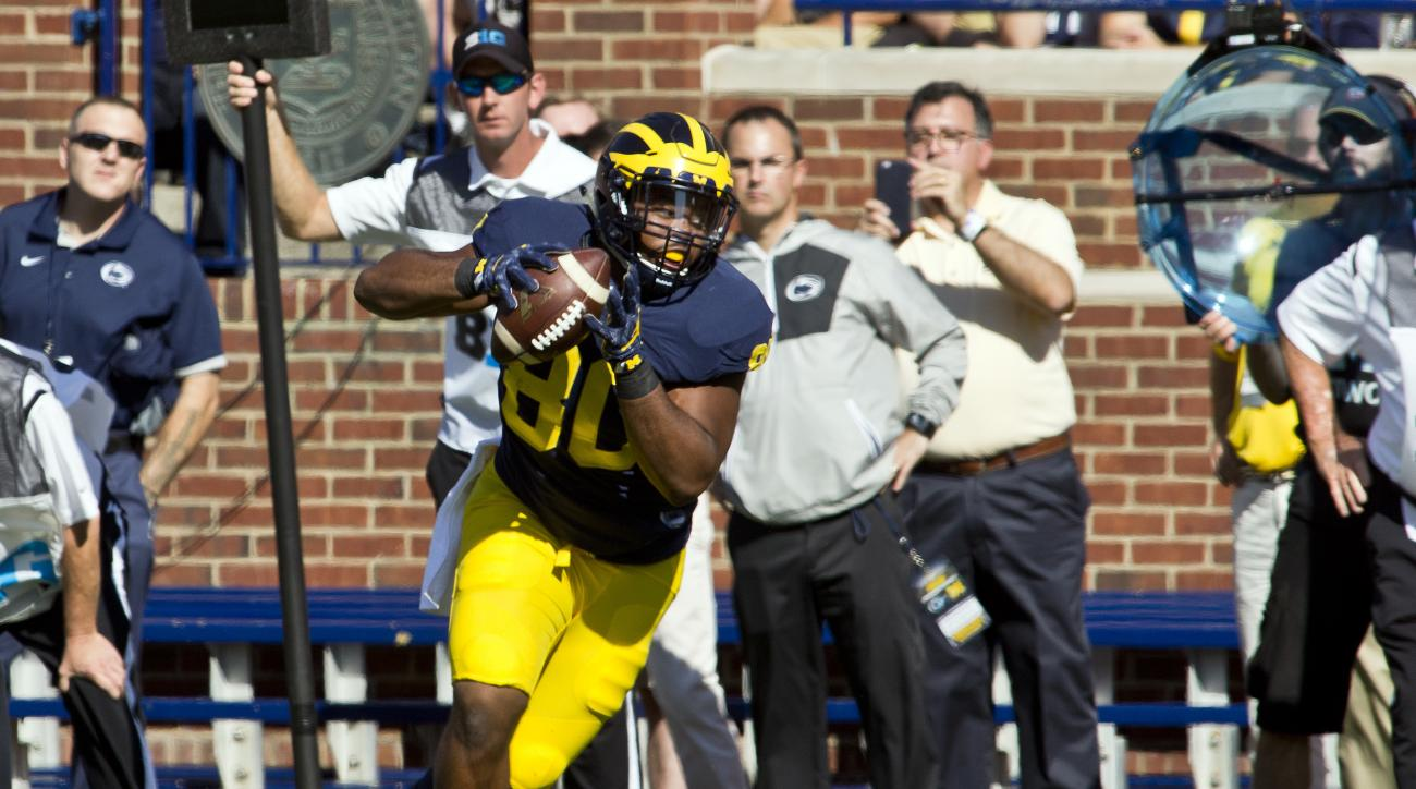 Michigan fullback Khalid Hill (80) catches a pass and rushes for a touchdown in the first quarter of an NCAA college football game against Penn State at Michigan Stadium in Ann Arbor, Mich., Saturday, Sept. 24, 2016. (AP Photo/Tony Ding)