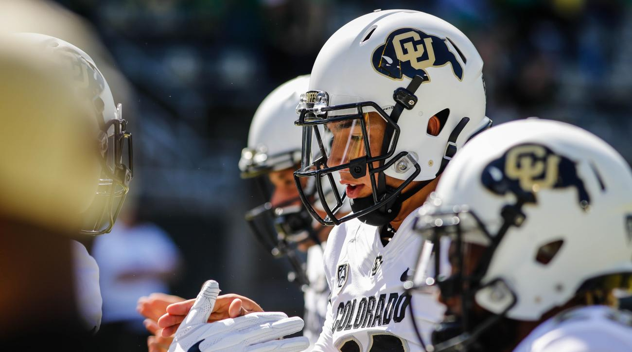 Colorado Buffaloes quarterback Steven Montez (12), interacts with teammates before playing Oregon in an NCAA college football game Saturday, Sept. 24, 2016, in Eugene, Ore. (AP Photo/Thomas Boyd)