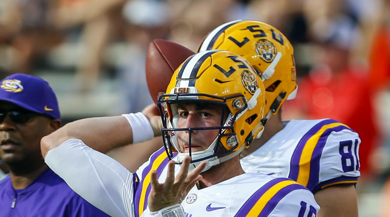 LSU quarterback Danny Etling (16) warms up before the first half of an NCAA college football game against Auburn, Saturday, Sept. 24, 2016, in Auburn, Ala. (AP Photo/Butch Dill)