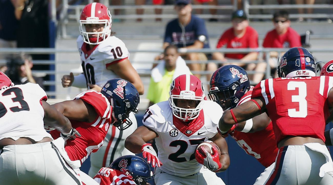 Georgia running back Nick Chubb (27) runs against Mississippi in the first half of their NCAA college football game, Saturday, Sept. 24, 2016, in Oxford, Miss. No. 23 Mississippi won 45-14. (AP Photo/Rogelio V. Solis)