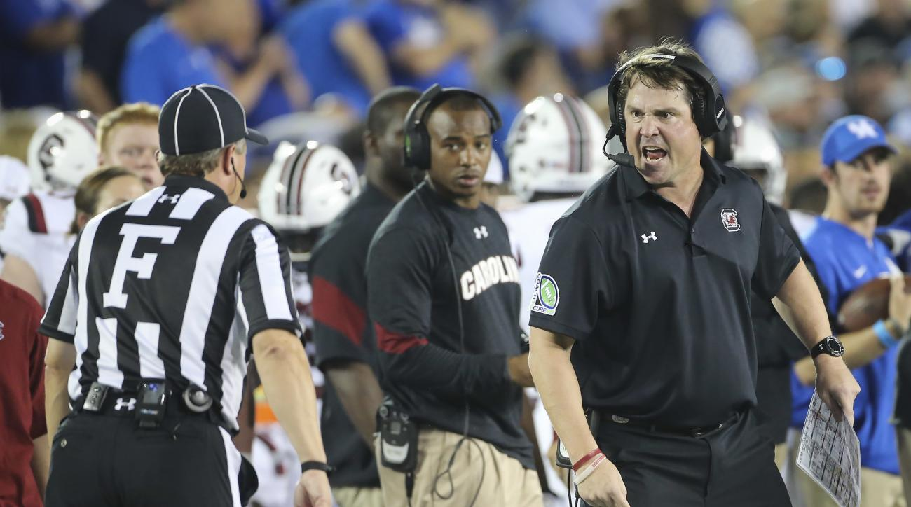 South Carolina head coach Will Muschamp yells at a referee after a penalty call against his team in the first half of an NCAA college football game against Kentucky Saturday, Sept. 24, 2016, in Lexington, Ky. (AP Photo/David Stephenson)