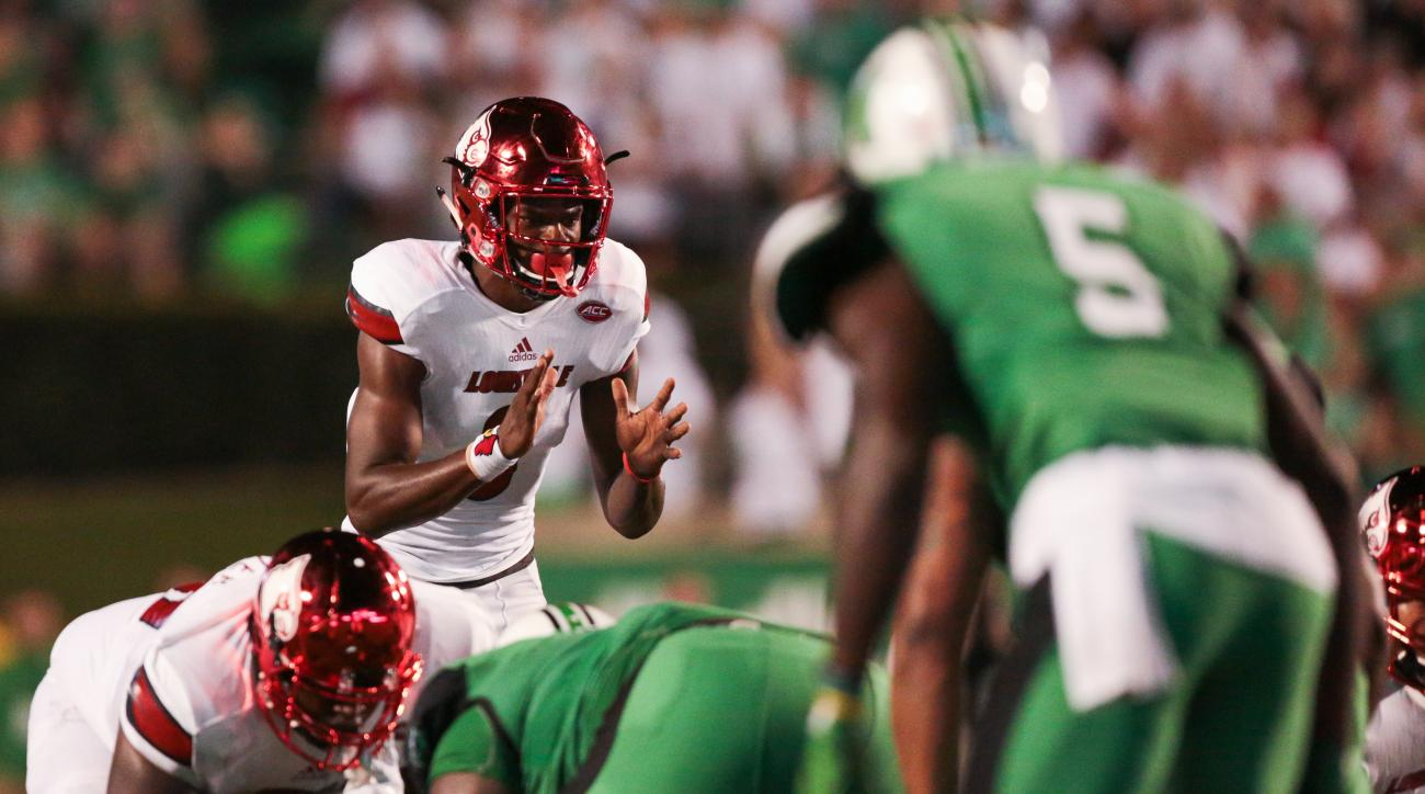 Louisville quarterback Lamar Jackson (8) awaits the snap during the first half of an NCAA college football game in Huntington, W. Va., Saturday Sept. 24, 2016. (AP Photo/Walter Scriptunas II)
