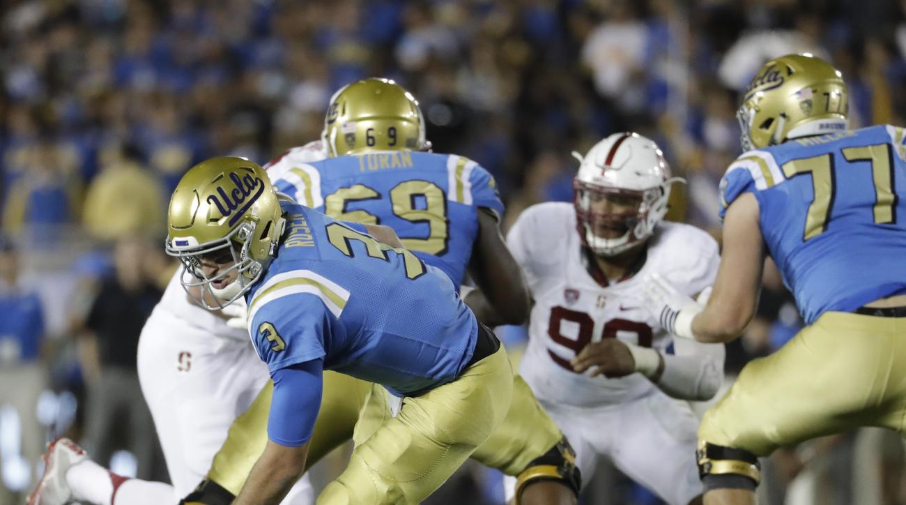 UCLA quarterback Josh Rosen chases the ball after missing the snap during the second half of an NCAA college football game against Stanford in Pasadena, Calif., Saturday, Sept. 24, 2016. Stanford won 22-13. (AP Photo/Chris Carlson)
