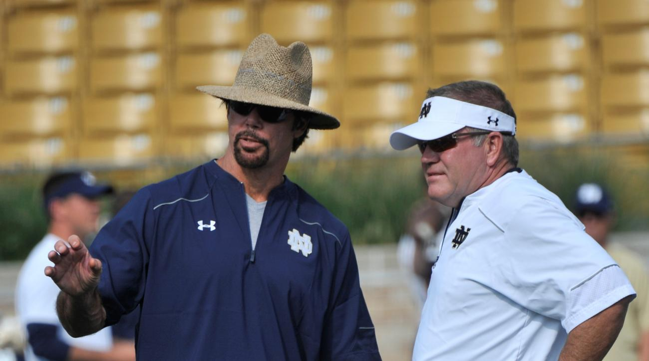 FILE - In an Aug. 29, 2014 file photo, Notre Dame coach Brian Kelly, right, talks with defensive coordinator Brian VanGorder during practice during media day for a NCAA football team in South Bend, Ind. It was announced Sunday, Sept. 25, 2016, that Notre