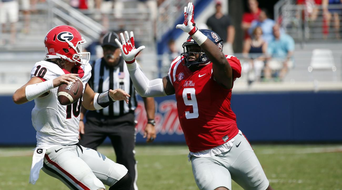 File-This Sept. 24, 2016, file photo shows Mississippi defensive tackle Breeland Speaks (9) rushing Georgia quarterback Jacob Eason (10) into a pass in the second half of their NCAA college football game in Oxford, Miss.  The Rebels have outscored opponen