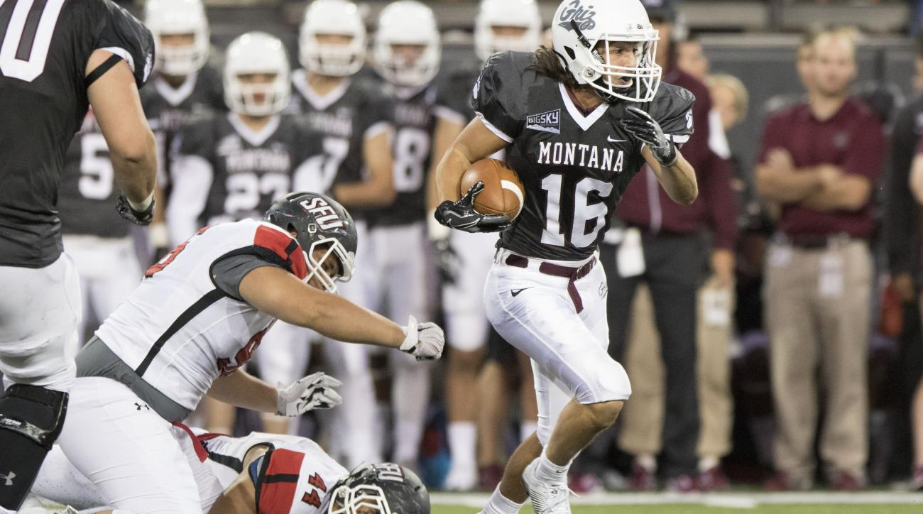 Montana wide receiver Jerry Louie-McGee (16) breaks a St. Francis tackle in the first half of an NCAA college football game Saturday, Sept. 3, 2016, in Missoula, Mont. (AP Photo/Patrick Record)