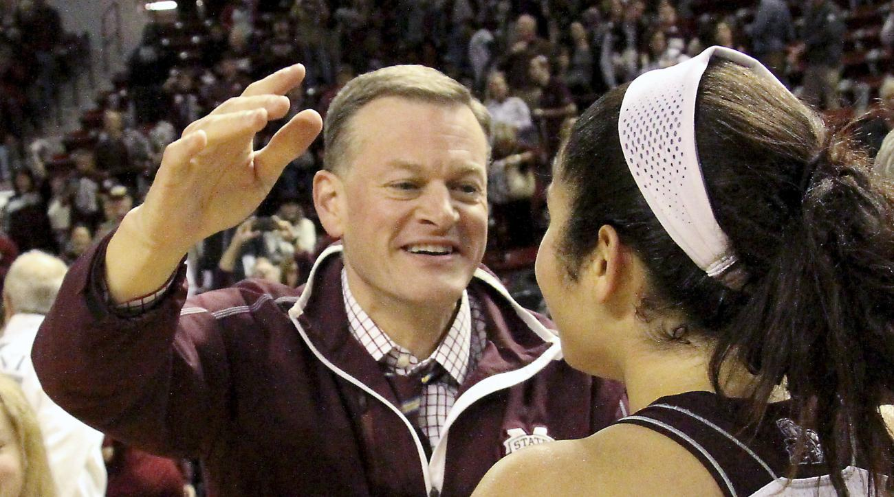 FILE - In this Jan. 28, 2016, file photo, Mississippi State athletic director Scott Stricklin congratulates Dominique Dillingham following the team's NCAA college basketball game against Tennessee in Starkville, Miss. A person familiar with the search say