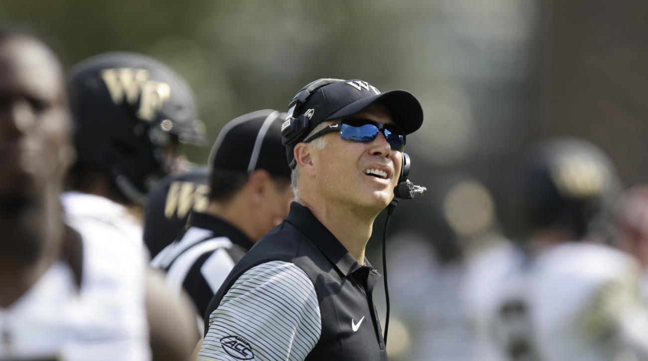 FILE - In this Sept. 10, 2016, file photo, Wake Forest head coach Dave Clawson watches during the first half of an NCAA college football game against Duke in Durham, N.C. Theres a surprise team joining No. 3 Louisville and No. 5 Clemson in the three-way t