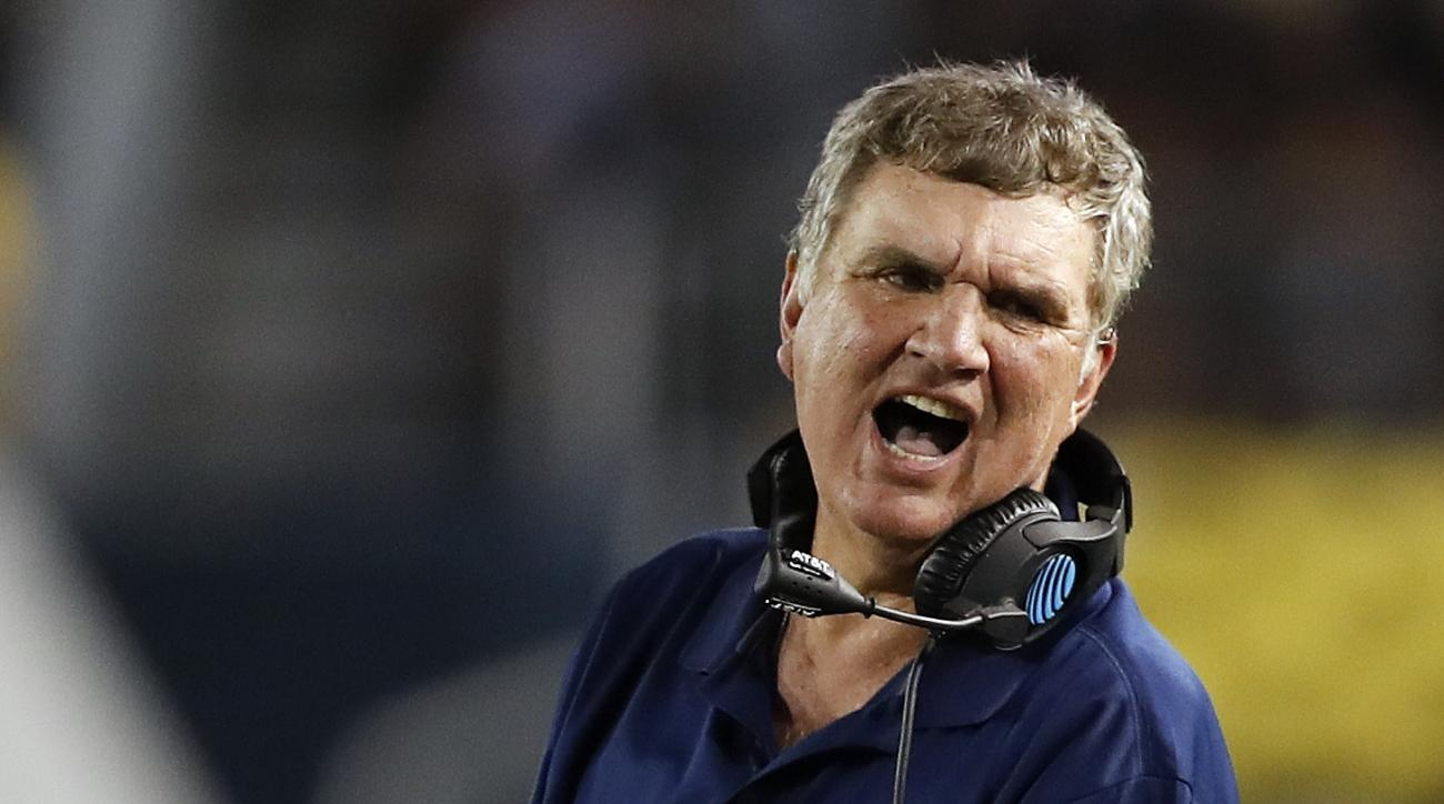 FILE - In this Thursday, Sept. 22, 2016, file photo, Georgia Tech head coach Paul Johnson talks with an assistant in the first half of an NCAA college football game against Clemson in Atlanta. After being manhandled by Clemson in a loss that inspired memo