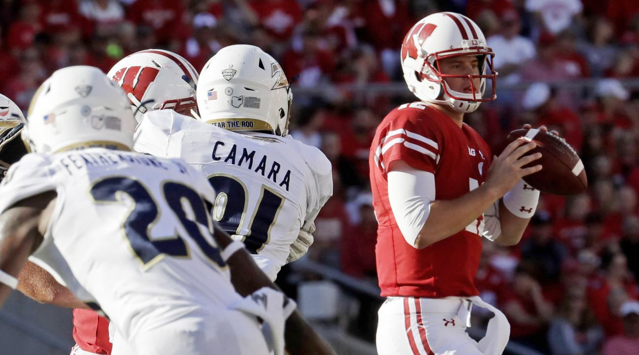 FILE - In this Sept. 10, 2016, file photo, Wisconsin quarterback Alex Hornibrook drops back to pass during the second half of an NCAA college football game against Akron in Madison, Wis. One start into his college career and has already proven that he can