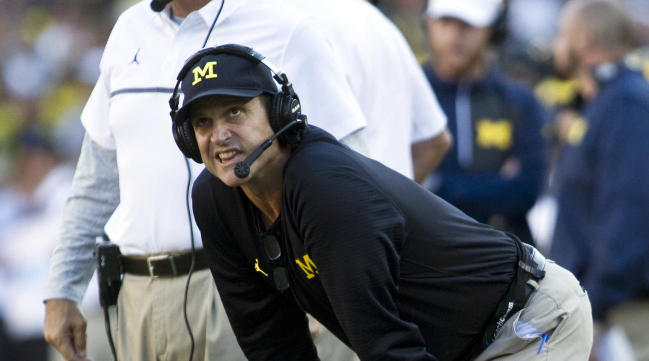 FILE - In this Sept. 24, 2016, file photo, Michigan head coach Jim Harbaugh reacts on the sidelines to a pass interference penalty called on Michigan in the third quarter of an NCAA college football game against Penn State at Michigan Stadium in Ann Arbor