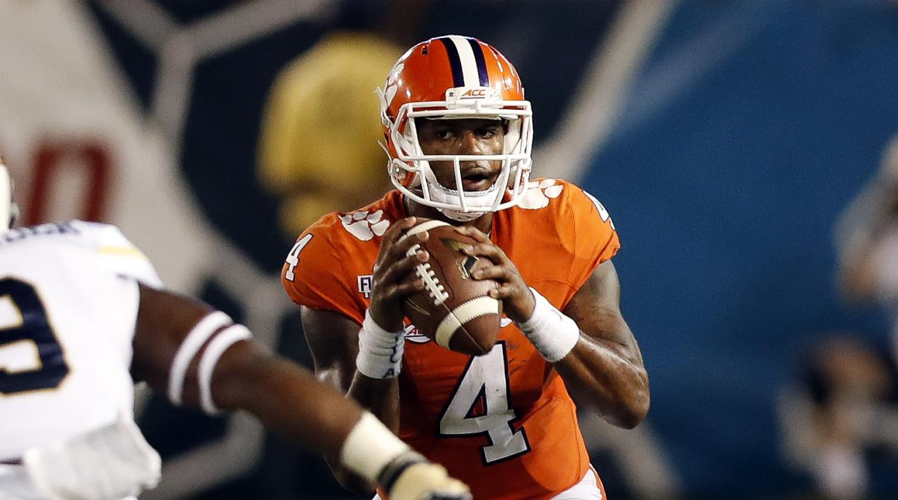 FILE - In this Sept. 22, 2016, file photo, Clemson quarterback Deshaun Watson (4) looks to throw against Georgia Tech in the first half of an NCAA college football game in Atlanta. Third-ranked  Louisville can take a commanding lead in the ACC Atlantic ra