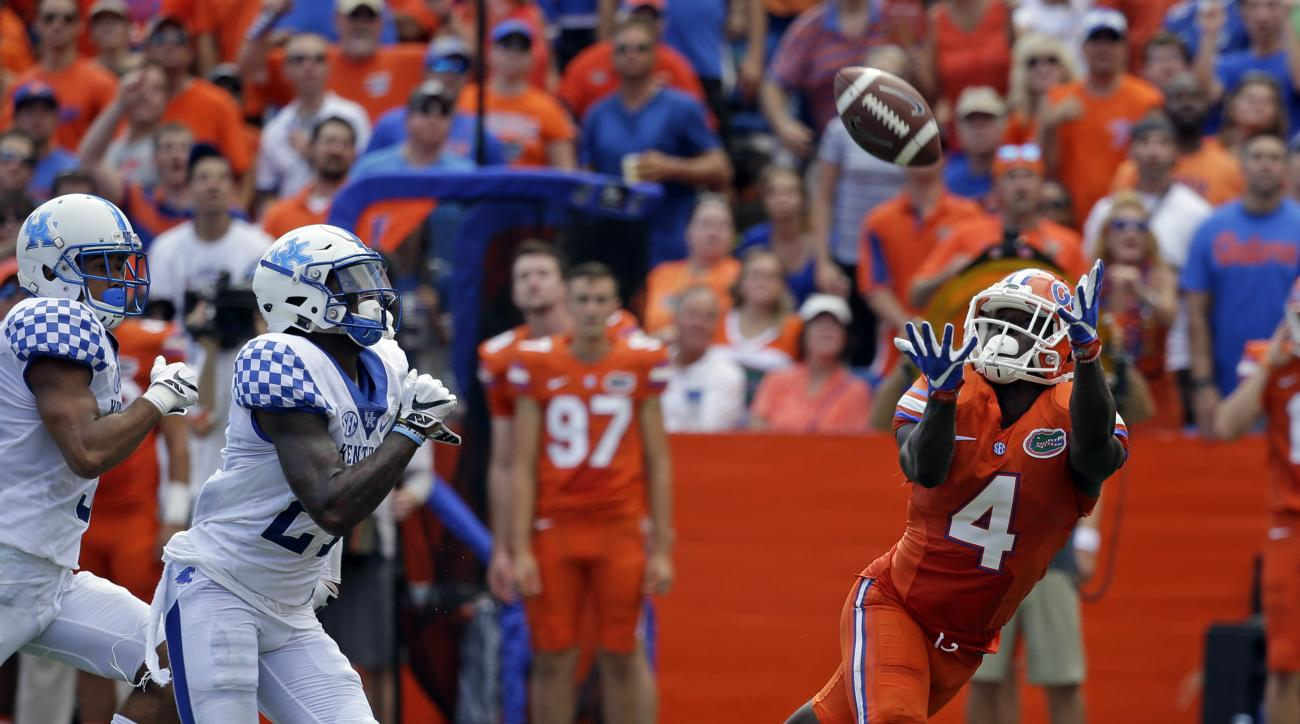 Florida wide receiver Brandon Powell (4) goes up for a pass against Kentucky in the first half of an NCAA college football game, Saturday, Sept. 10, 2016, in Gainesville, Fla. (AP Photo/John Raoux)