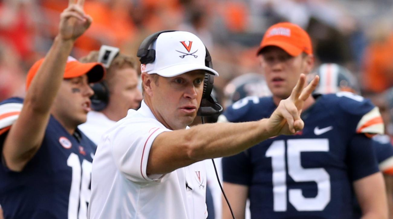 FILE - In this Sept. 3, 2016, file photo, Virginia head coach Bronco Mendenhall calls for a two-point conversion during the second half of an NCAA college football game in Charlottesville, Va. The continuing evolution of spread and no-huddle offenses in c