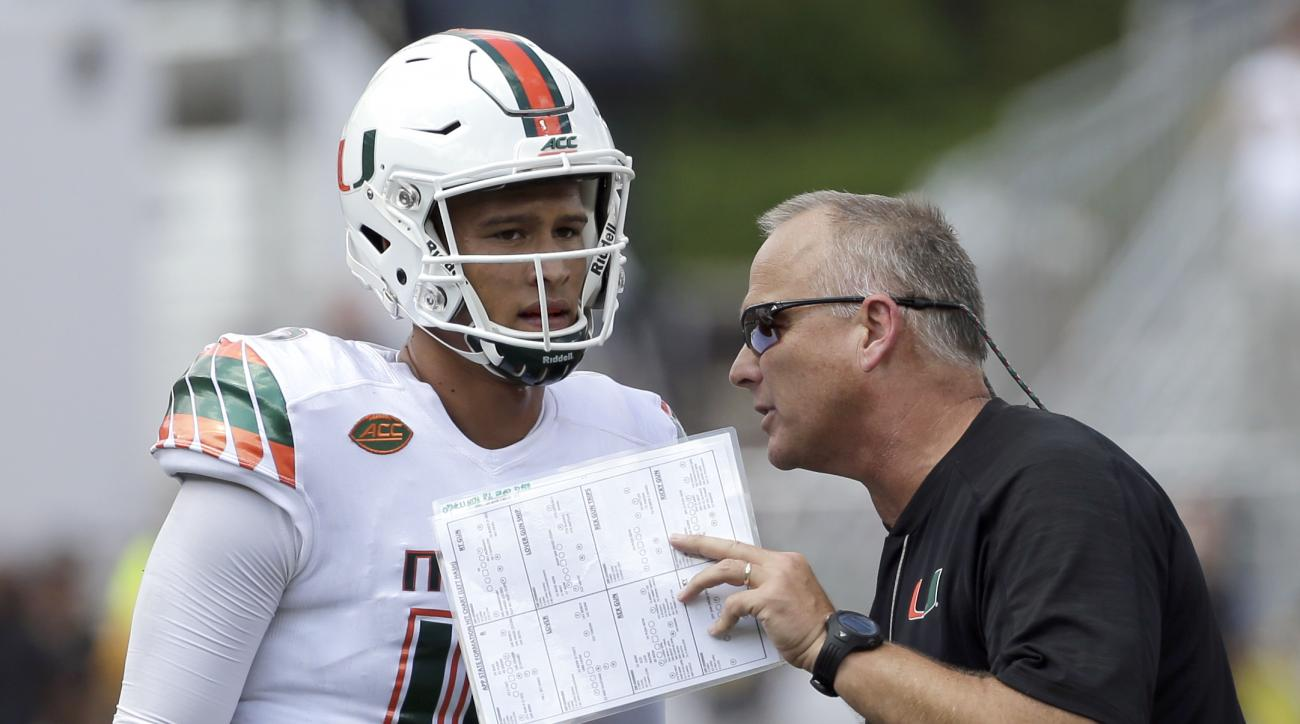 FILE - In this Sept. 17, 2016, file photo, Miami head coach Mark Richt, right, talks with quarterback Brad Kaaya (15) during the second half of an NCAA college football game against Appalachian State in Boone, N.C. Richt was 8-0 when his Georgia teams vis