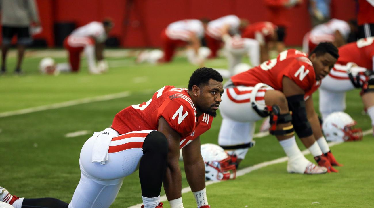 FILE - In this Aug. 11, 2015, file photo,Nebraska linebacker Michael Rose-Ivey (15) warms up during NCAA college football practice in Lincoln, Neb. The 15th-ranked Cornhuskers, who last week avenged a loss to Northwestern, will host Illinois on Saturday,