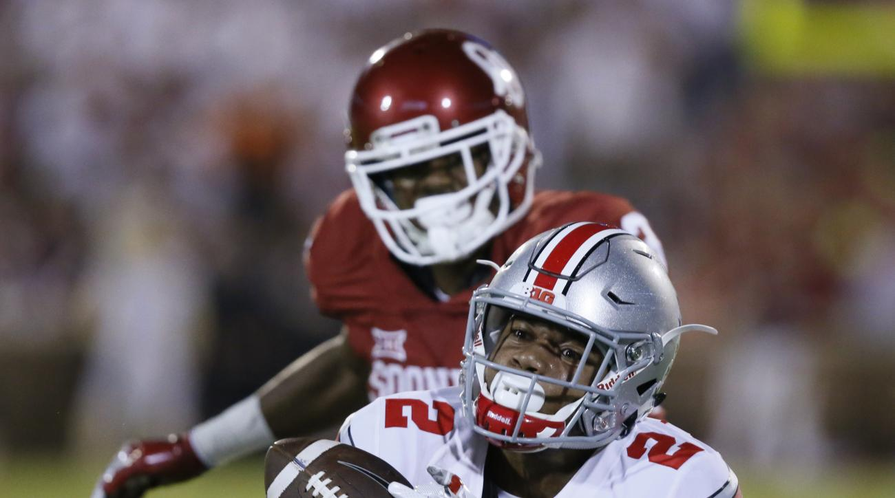 FILE - In this Sept. 17, 2016, file photo, Ohio State cornerback Marshon Lattimore (2) gets his hands on a pass intended for Oklahoma wide receiver A.D. Miller, rear, but can't hold on, on an incomplete pass during the fourth quarter of an NCAA college fo