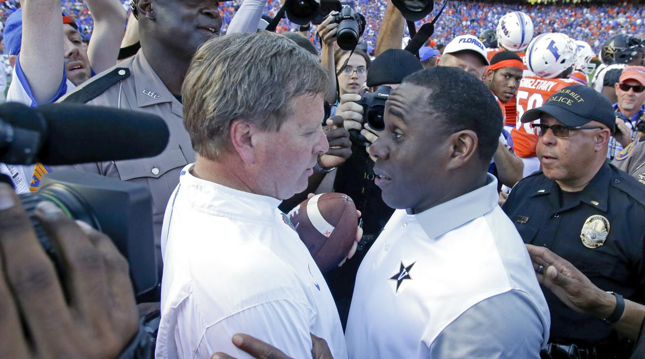FILE - In this Nov. 7, 2015, file photo, Florida head coach Jim McElwain, left, greets Vanderbilt head coach Derek Mason, right, after Florida won 9-7 in an NCAA college football game in Gainesville, Fla. The Gators have an opportunity Saturday to prove t