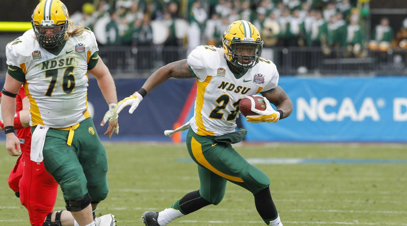 North Dakota State running back King Frazier carries the ball during the FCS Championship NCAA college football game against Illinois State Saturday, Jan. 10, 2015, in Frisco, Texas.   North Dakota State won the game 29-27 for their fourth straight nation
