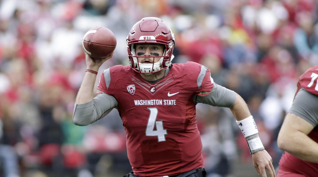 FILE - In this Saturday, Sept. 17, 2016, file photo, Washington State quarterback Luke Falk (4) looks for a receiver as he runs with the ball during the first half of an NCAA college football game against Idaho in Pullman, Wash. Washington State defeated