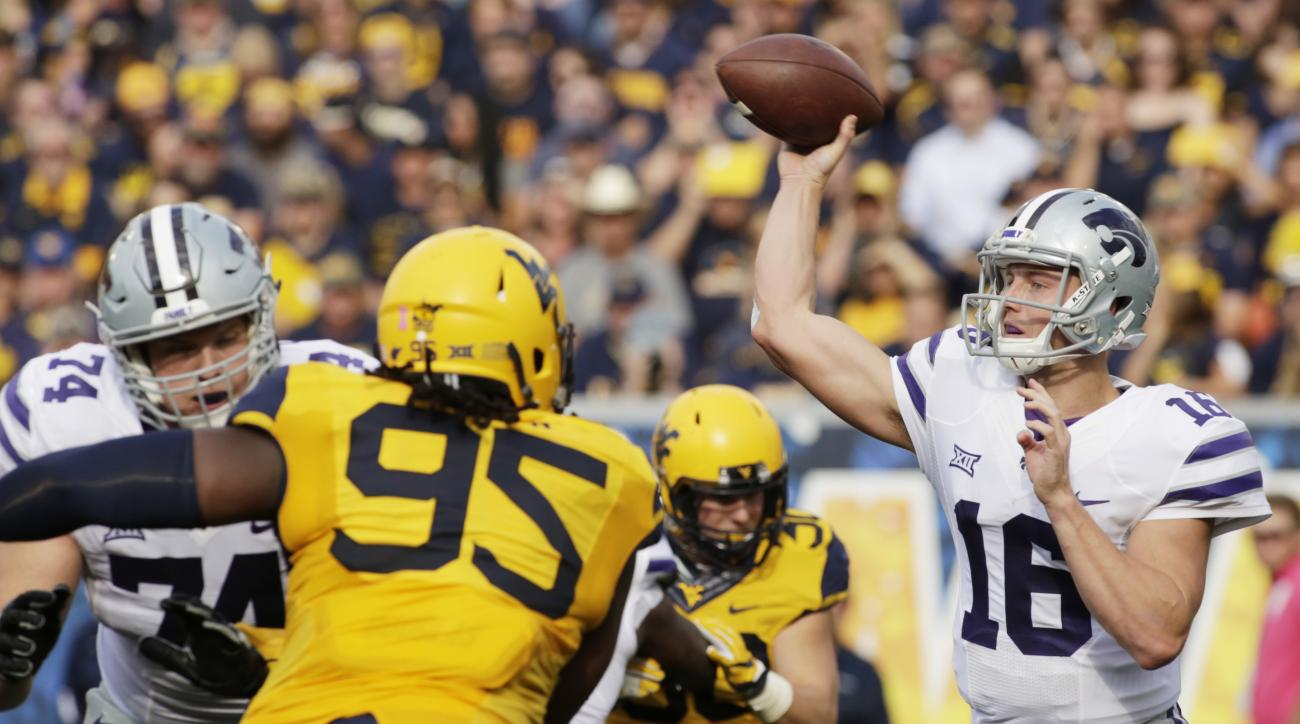 Kansas State quarterback Jesse Ertz (16) attempts a pass during the first half of an NCAA college football game against West Virginia, Saturday, Oct. 1, 2016, in Morgantown, W.Va. (AP Photo/Raymond Thompson)