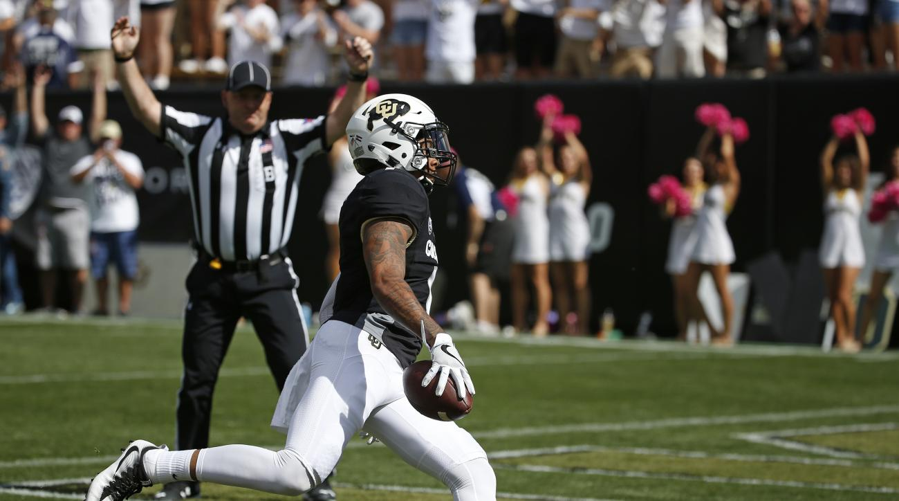 Colorado wide receiver Shay Fields (1) runs in a catch for a touchdown against Oregon State during the first half of an NCAA college football game in Boulder, Colo., Saturday, Oct. 1, 2016. (AP Photo/Brennan Linsley)