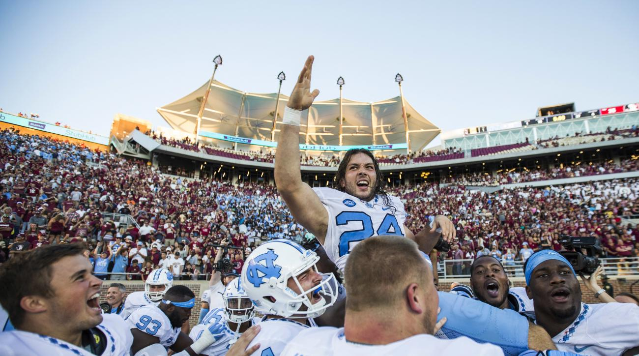 Players from North Carolina hoist kicker Nick Weiler on their shoulders after Weiler kicked the game winning 54-yard field goal against Florida State in an NCAA college football game in Tallahassee, Fla., Saturday, Oct. 1, 2016. North Carolina defeated Fl