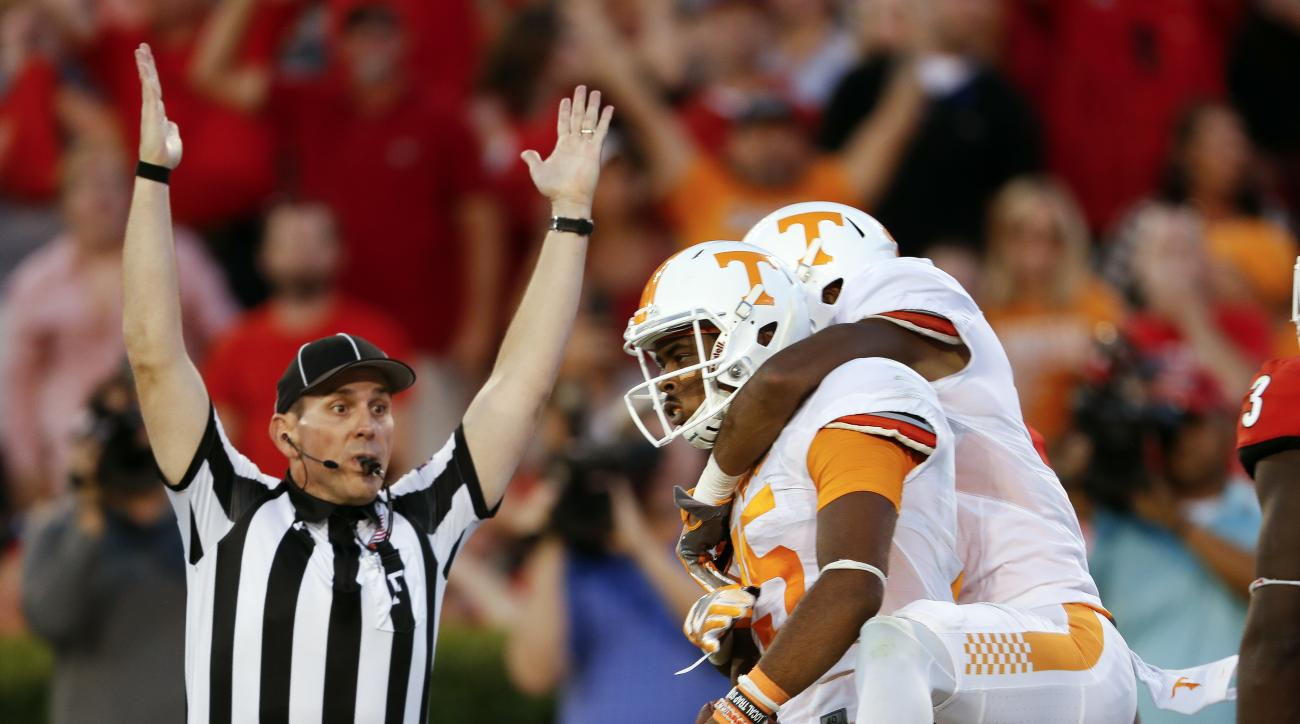 Tennessee wide receiver Jauan Jennings (15) celebrates with Tennessee wide receiver Josh Malone (3) after making a last-second touchdown catch to defeat Georgia 34-31 in an NCAA college football game Saturday, Oct. 1, 2016, in Athens, Ga. (AP Photo/John B