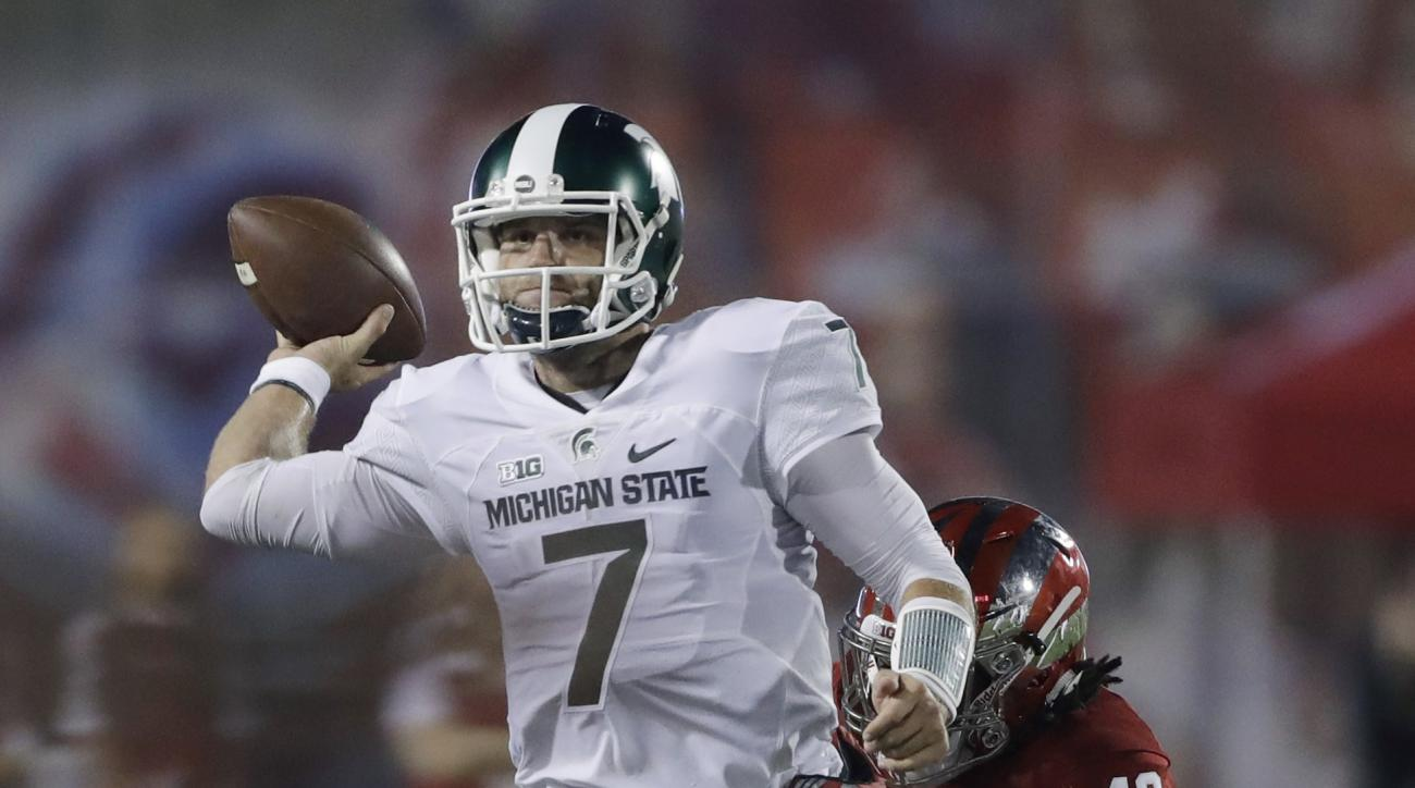 Michigan State quarterback Tyler O'Connor (7) is pressured by Indiana defensive back Marcelino Ball (42) as he tries to pass during the first half of an NCAA college football game, Saturday, Oct. 1, 2016, in Bloomington, Ind. (AP Photo/Darron Cummings)