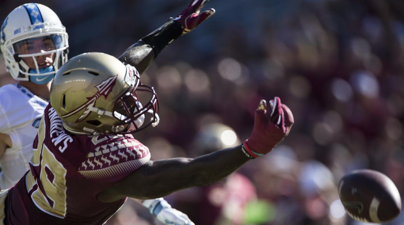 Florida State defensive back Nate Andrews attempts to intercept a North Carolina pass in the first half of an NCAA college football game in Tallahassee, Fla., Saturday, Oct. 1, 2016. North Carolina defeated Florida State 37-35. (AP Photo/Mark Wallheiser)