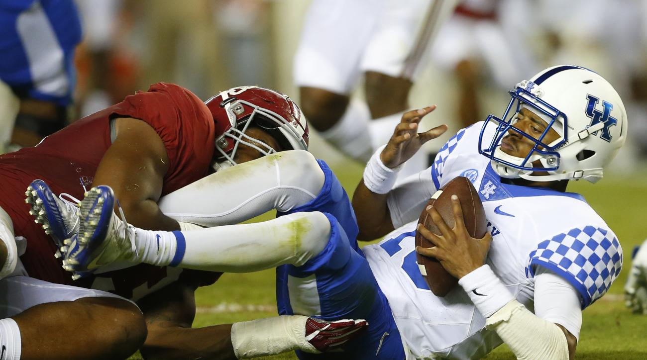 Kentucky quarterback Stephen Johnson (15) is sacked by Alabama defensive lineman Jonathan Allen, left, during the first half of an NCAA college football game, Saturday, Oct. 1, 2016, in Tuscaloosa, Ala. (AP Photo/Butch Dill)