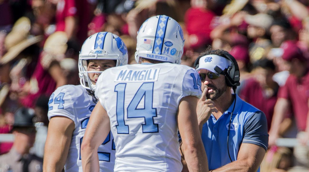 North Carolina head coach Larry Fedora talks with his kicker Nick Weiler (24) and holder Logan Byrd in the first half of an NCAA college football game against Florida State in Tallahassee, Fla., Saturday, Oct. 1, 2016. North Carolina defeated Florida Stat