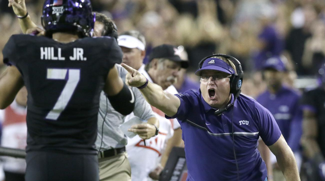 TCU head coach Gary Patterson, right, yells at quarterback Kenny Hill (7) during the second half of an NCAA college football game, Saturday, Oct. 1, 2016, in Fort Worth, Texas. Oklahoma won 52-46. (AP Photo/LM Otero)