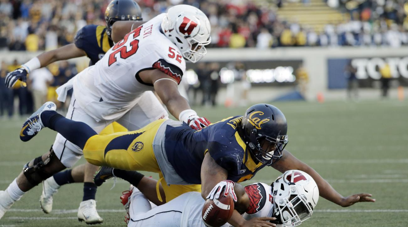 Utah running back Zack Moss, bottom, is stopped just shy of the end zone by California defensive tackle James Looney on the last play of an NCAA college football game Saturday, Oct. 1, 2016, in Berkeley, Calif. California won 28-23. (AP Photo/Marcio Jose