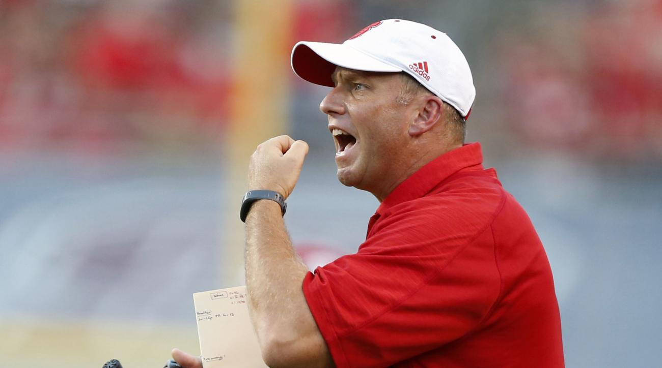 FILE - In this Sept. 17, 2016, file photo, North Carolina State head coach Dave Doeren argues a call during the first half of an NCAA college football game against Old Dominion at Carter-Finley Stadium in Raleigh, N.C. North Carolina State suddenly seems