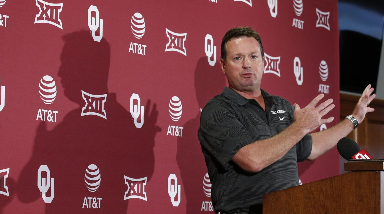 Oklahoma head coach Bob Stoops gestures as he speaks during an NCAA college football news conference in Norman, Okla., Monday, Oct. 3, 2016. This year's Texas-Oklahoma game is extra important for the coaches. Oklahoma's Bob Stoops and Texas' Charlie Stron