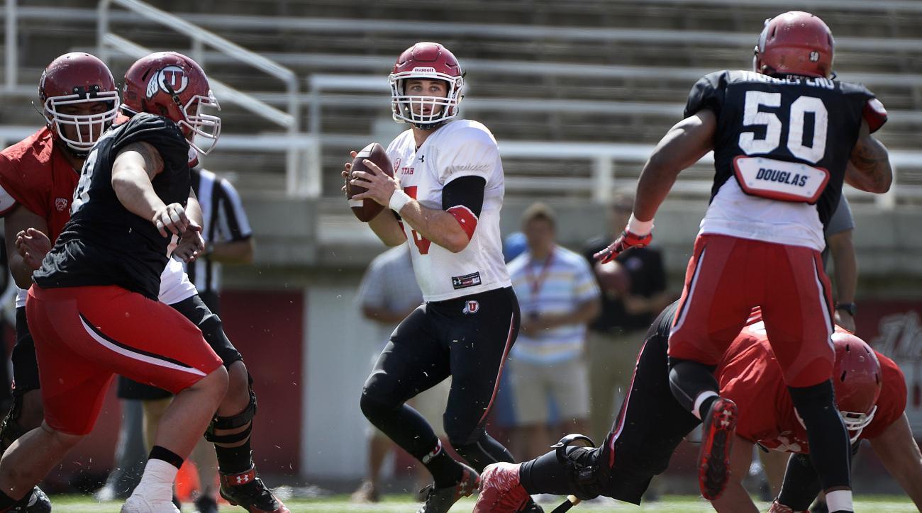 FILE - In this April 11, 2015, file photo, Utah quarterback Chase Hansen looks to throw during a scrimmage at Rice-Eccles Stadium in Salt Lake City. Redshirt sophomore Hansen was the quarterback of the future when he arrived at Utah, but circumstances pus