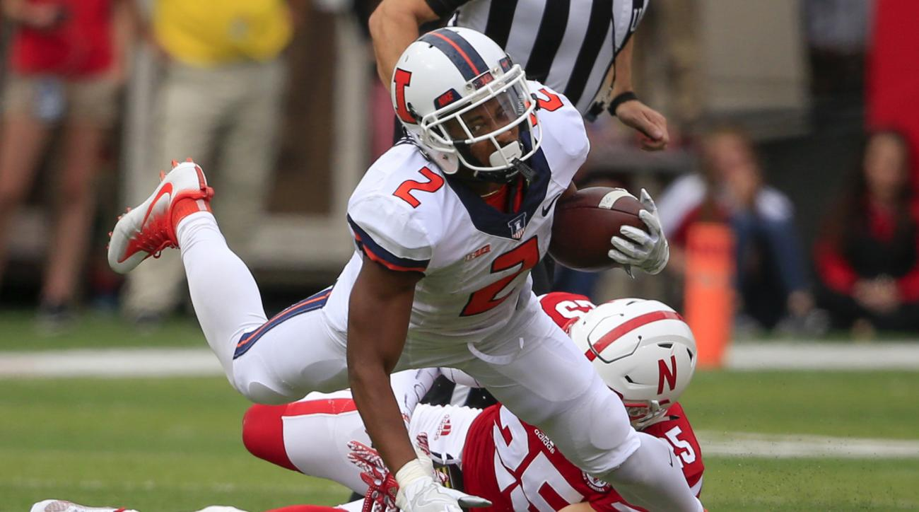 FILE - In this Oct. 1, 2016, file photo, Illinois running back Reggie Corbin (2) is tripped up by Nebraska safety Nate Gerry (25) during  an NCAA college football game in Lincoln, Neb. When Lovie Smith took the head coaches job at Illinois, he said his te
