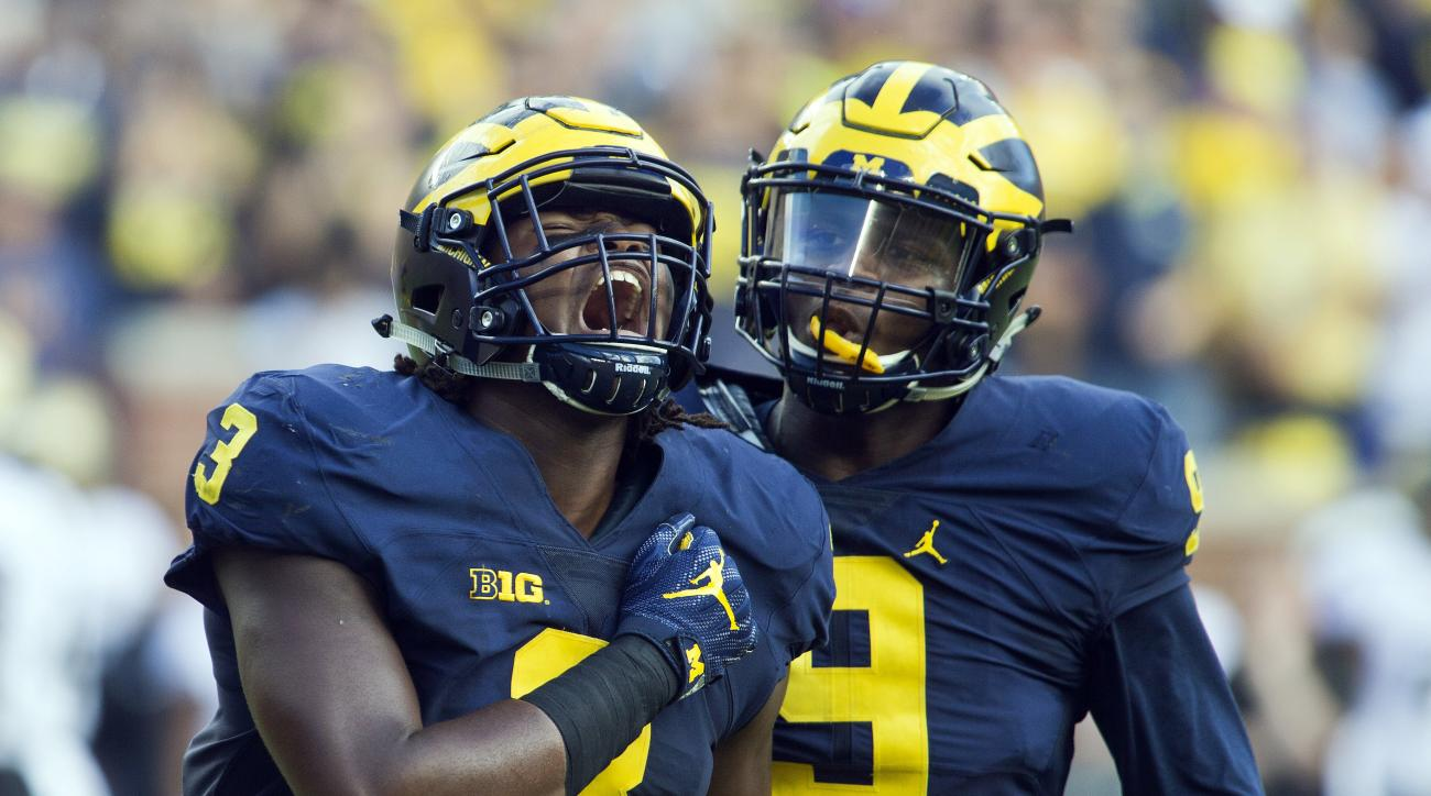 FILE - In this Sept. 17, 20126, file photo, Michigan defensive end Rashan Gary (3) celebrates a sack alongside linebacker Mike McCray (9) in the first half of an NCAA college football game against Colorado,  in Ann Arbor, Mich. Gary is meeting the high ex
