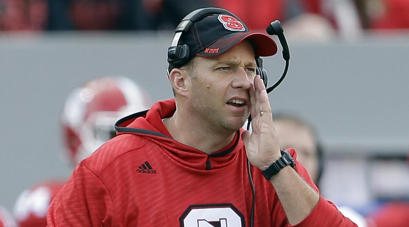 FILE - In this Nov. 8, 2014, file photo, North Carolina State coach Dave Doeren yells during the second half of an NCAA college football game against Georgia Tech in Raleigh, N.C. Notre Dame (2-3) visits the Wolfpack (3-1) on Saturday in a game that could