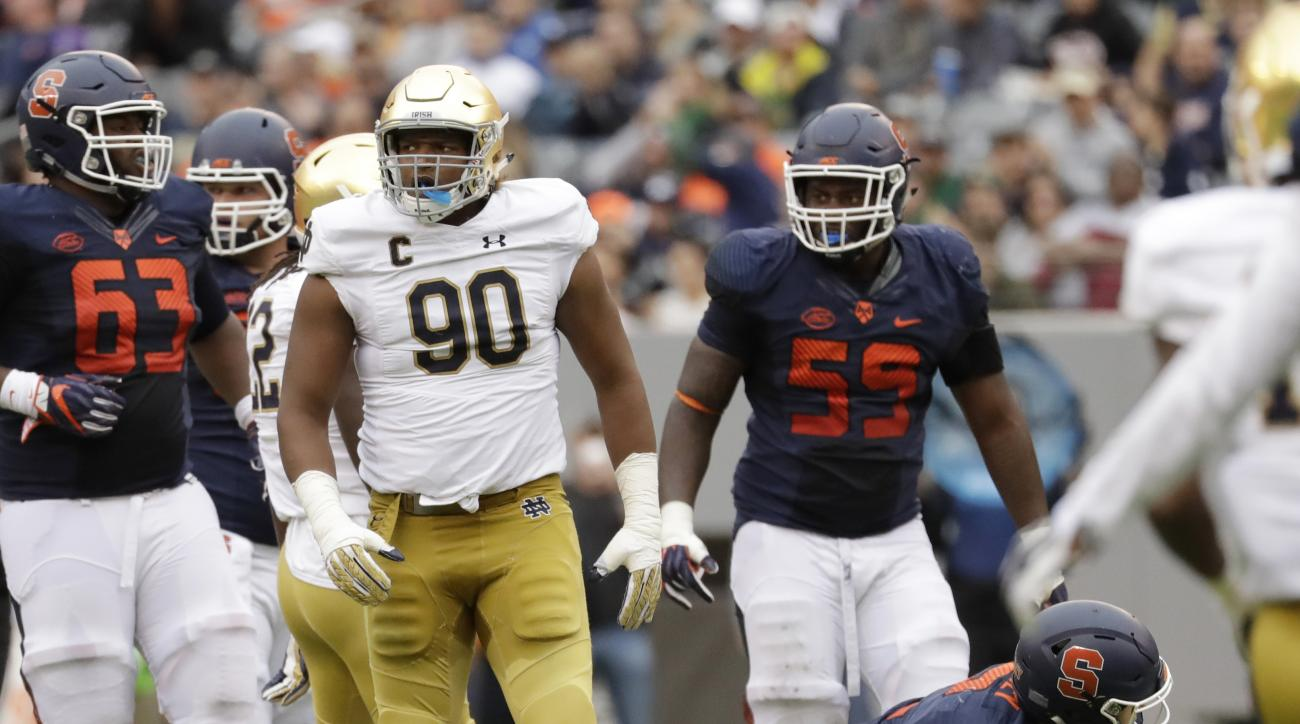 FILE - In this Oct. 1, 2016, file photo, Notre Dame defensive lineman Isaac Rochell (90) walks away after sacking Syracuse quarterback Eric Dungey (2) during the first half of an NCAA college football game at MetLife Stadium in East Rutherford, N.J. After