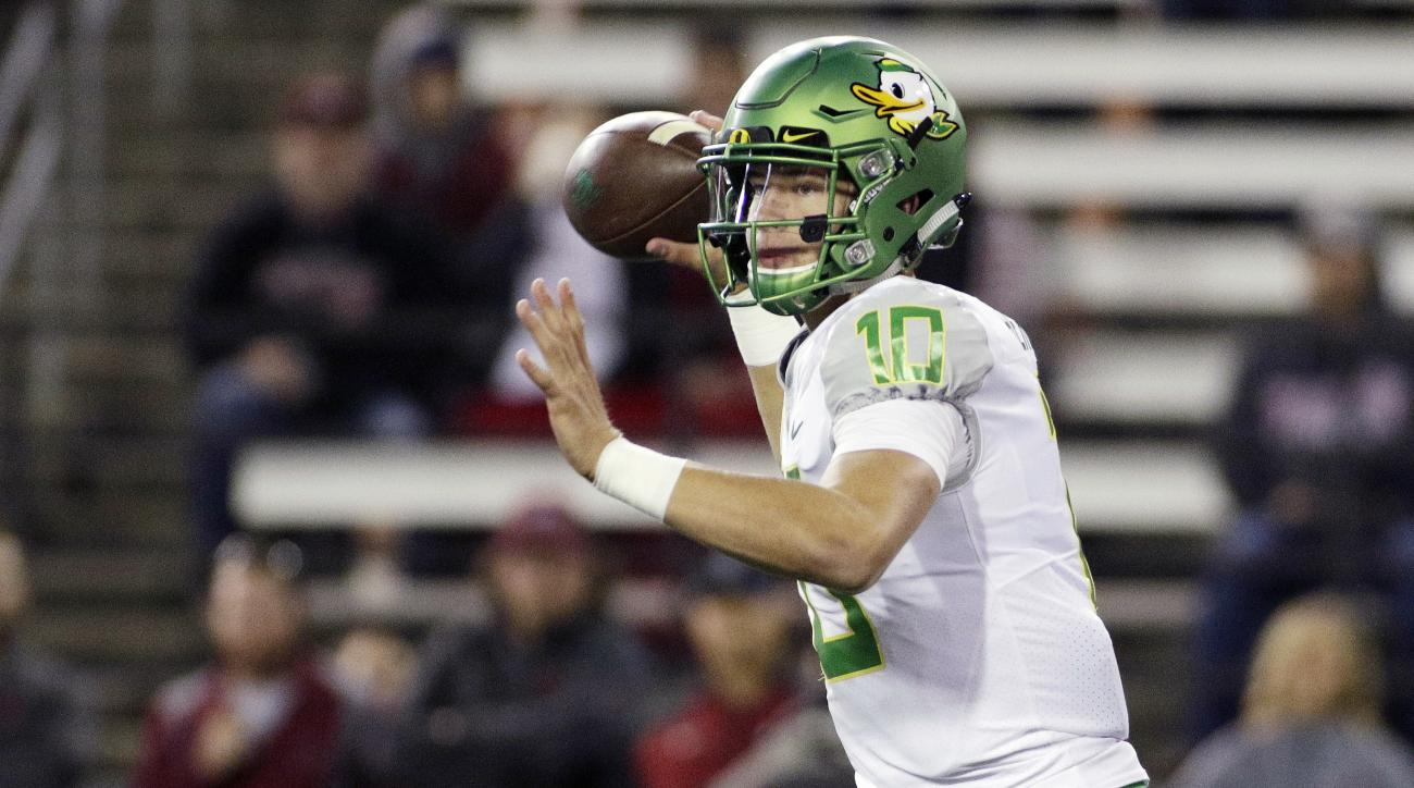 FILE - In this Oct. 1, 2016, file photo, Oregon quarterback Justin Herbert passes the ball during the second half of an NCAA college football game against Washington State in Pullman, Wash. Herbert has appeared in two games, competing three of five passes