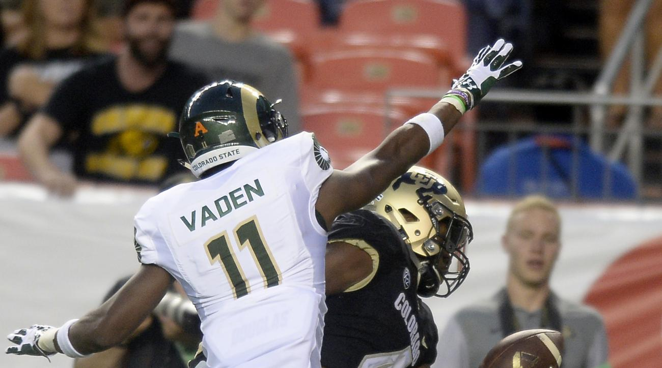 """FILE - In this Sept. 2, 2016, file photo, Colorado's Bryce Bobo makes a one-handed catch against Colorado States's Jordon Vaden during an NCAA college football game in Boulder, Colo. On the inside of his right biceps, Bobo has """"Antonio"""" tattooed in cursiv"""